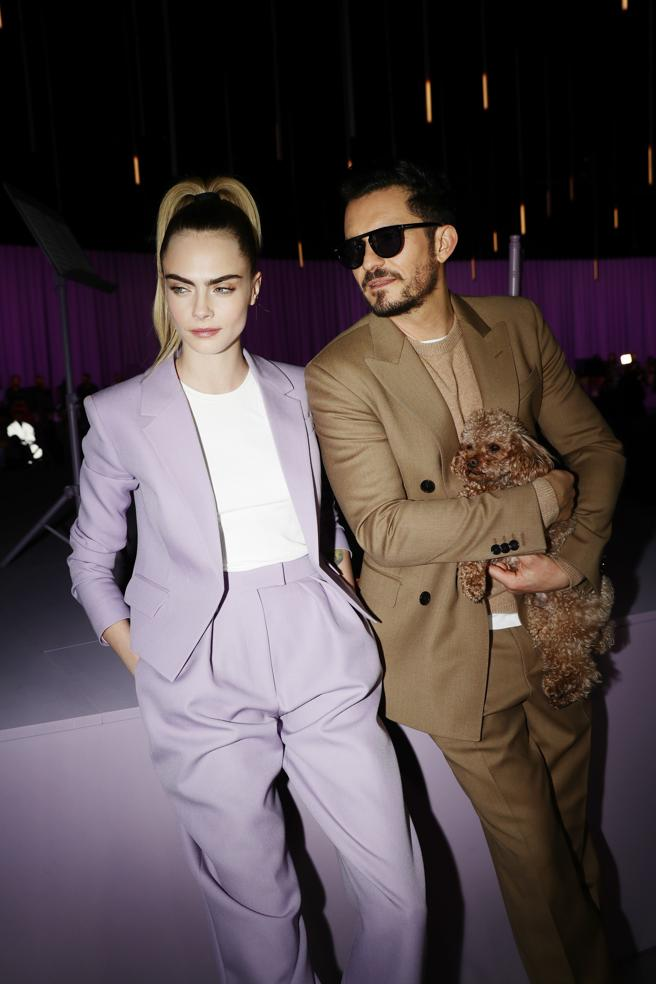 Cara Delevingne and Orlando Bloom at the parade of Hugo Boss in Milan