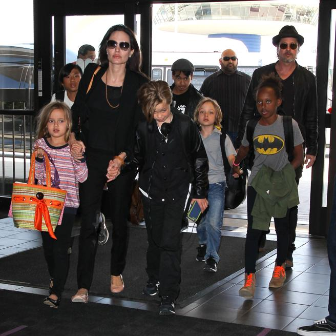 Brad Pitt and Angelina Jolie with their children Maddox, Paz, Zahara, Shiloh, Vivienne, and Knox in Los Angeles. 2015.