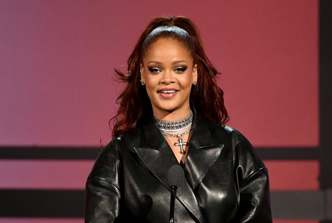 Rihanna, in solidarity with male violence.