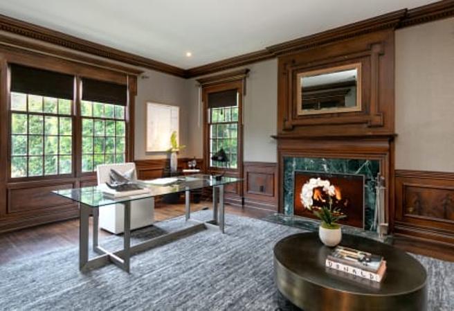 Office with mahogany panels.