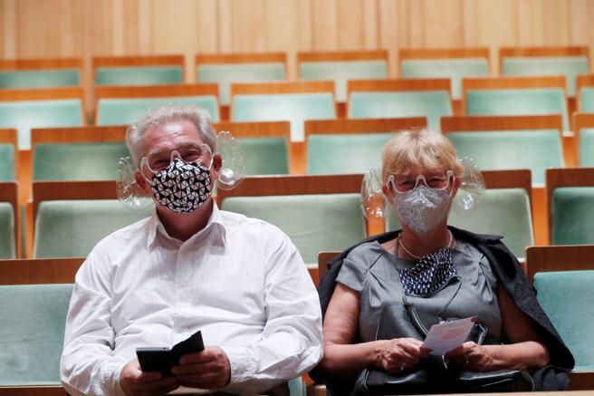 A couple tries on the mask devised by the conductor Iván Fischer in Budapest
