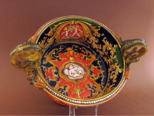 Centrotavola in ceramica con putto al centro