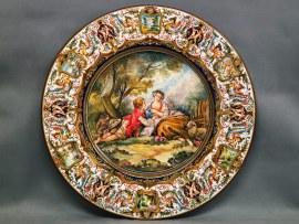 grande piatto ornamentale con scena pastorale di Boucher