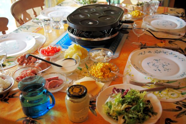 Pancakes and Parties Raucous Raclette Evenings with Family, Friends and Melted Cheese!