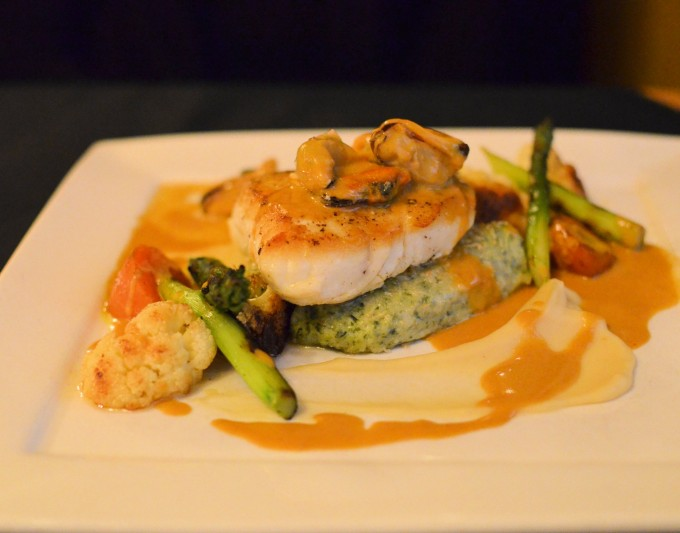 Pan-fried fresh Newfoundland Halibut with Gnocchi and Roasted Vegetables in a Seafood Sauce