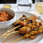 Singaporean Style Chicken and Lamb Satay Marinated, skewered and grilled chicken and lamb slices. Served with cucumber, ketupat rice cakes and spicy peanut sauce.