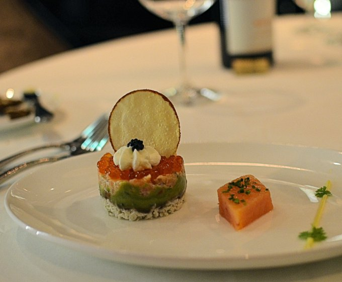 Smoked Salmon & Peekytoe Crab Parfait layered with Avocado, Salmon Caviar, Crème Fraîche and served with Petite Greens