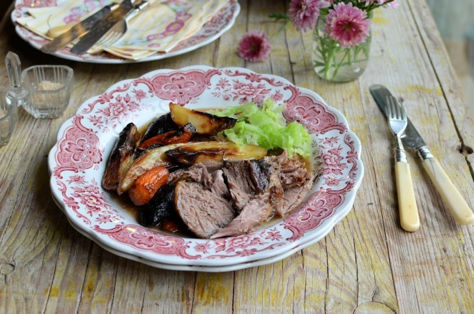 A fabulous French inspired recipe for slow roast lamb with a Dijon mustard crust, fresh herbs and garlic; this recipe makes its own red wine gravy that is infused with the herbs and garlic and is perfect for any special celebratory meal such as Easter or Mothering Sunday, as well as for a wonderful family Sunday lunch.