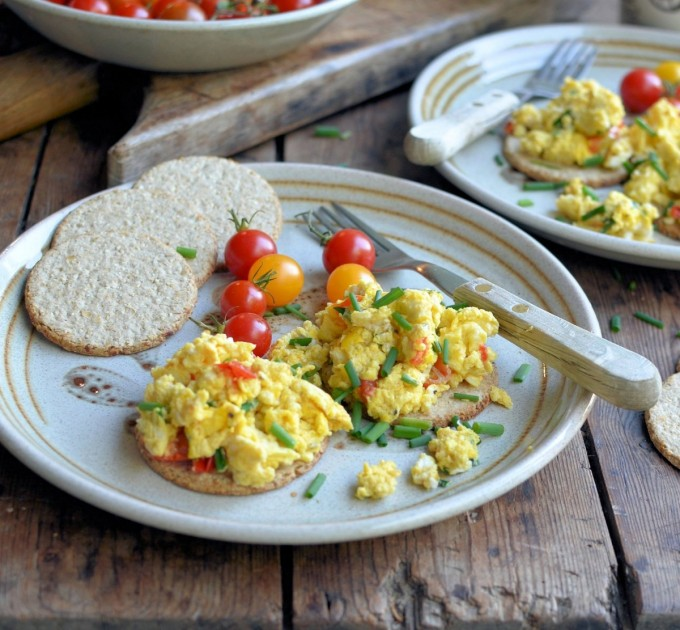 Scrambled Eggs on Oatcakes with Chives & Cherry Tomatoes.