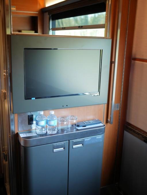 Flat screen TV and mini bar in the Prestige class cabin
