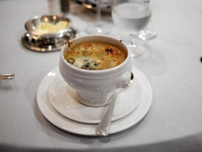 BLACK AND BLUE ONION SOUP Fresh Thyme, Jack Daniels, Roquefort Crust