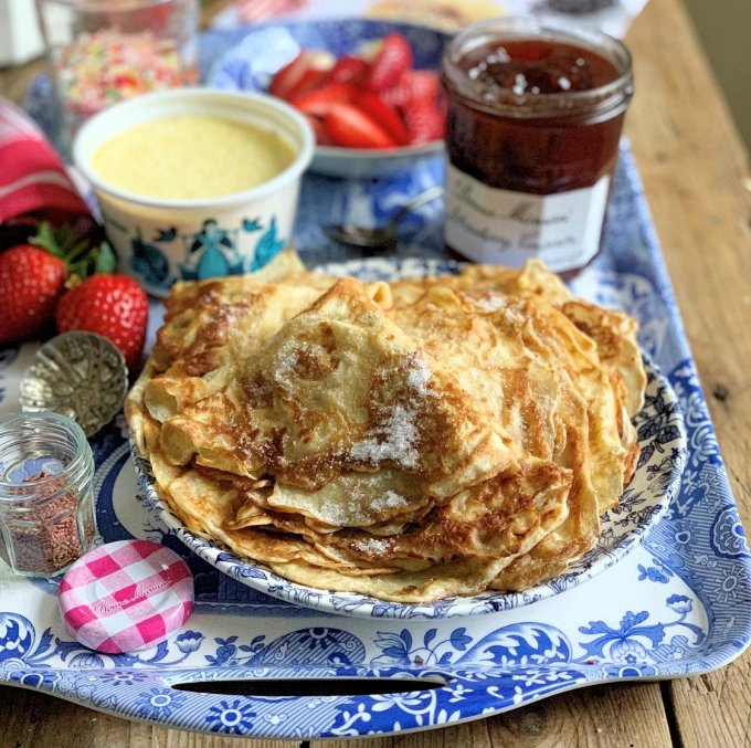 "A fun way to serve pancakes for the whole family - make a batch of crepe style pancakes, and then arrange all the ""fixings"" on a large platter, board or tray. I used Bonne Maman Strawberry Conserve, along with clotted cream, fresh strawberries and bananas, ""hundreds and thousands"" sprinkles and chocolate vermicelli."