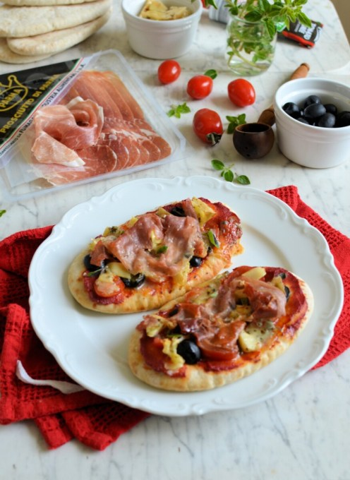 Bake in the pre-heated oven for about 10 minutes, or until the cheese has melted and the Prosciutto di Parma ham is crispy. Serve with more fresh oregano leaves scattered over as a garnish. Great when served with fresh salad and a selection of antipasti on the side.