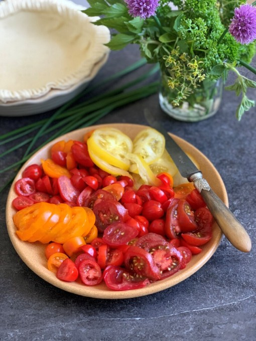 Slice all of the tomatoes, and roughly chop all of the herbs.