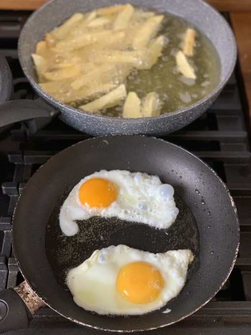 When the chips are nearly cooked, heat up some oil in another pan and add the eggs. Fry them to your taste, as in sunny-side up, over easy or over with the yolk broken.