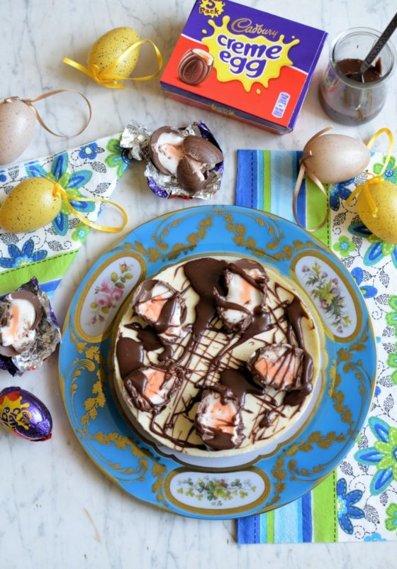 Cadbury Creme egg cheesecake by Georgia's Cakes     INGREDIENTS     ·         10 Cadbury Creme Eggs  ·         6 mini Cadbury Creme Eggs  ·         150g digestive biscuits  ·         75g melted butter  ·         750g full fat cream cheese  ·         150g icing sugar  ·         1 vanilla pod  ·         300ml double cream  ·         White chocolate, melted  ·         Dark Chocolate, melted  ·         Caramel sauce     Utensils  ·         8 inch cake ring or spring form tin  ·         Acetate     METHOD  1.       Line the inside of the tin or ring with some acetate - this will make it easier to remove the cheesecake after it's been set  2.       Crush the biscuits into fine crumbs and stir the melted butter in  3.       Pour into the cake tin and press around the bottom of the tin so the whole surface is covered and compact  4.       Put in the fridge to set  5.       Chop 5 of the Cadbury Creme Eggs up into small chunks and set to one side  6.       In a bowl, beat together the cream cheese, vanilla seeds from the vanilla pod and sifted icing sugar  7.       In a separate bowl, whisk the double cream until it's just started to firm up  8.       Gently fold the cream into the cream cheese mix until it's combined  9.       Add the chopped up Creme Eggs and mix in  10.   Take out the cake tin with the biscuit case  11.   Cut the remaining Cadbury Creme Eggs in half - length ways - and arrange them facing out around the sides of the cake tin (use the goo to make them stick to the sides!)  12.   Pour in the cheesecake mix and flatten off the top with a spatula or palette knife  13.   Set in refrigerator for at least 1 hour  14.   Once set, take out the fridge and remove the tin being careful with the outside of the cake  15.   If applied, remove the acetate too  16.   Drizzle over some white chocolate, dark chocolate and caramel sauce in a criss cross pattern  17.   Cut the mini Creme Eggs in half - length ways and - arrange around the outside of the cheesecake