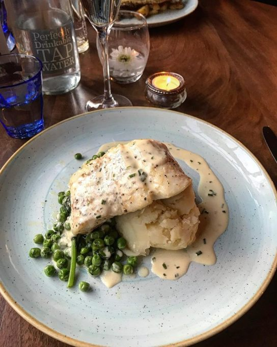 Hake with creamy mash, truffled peas in a butter chive sauce