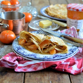 Delicious golden, lacy pancakes served with warm sweet clementines in a bitter orange marmalade sauce with Grand Marnier as a boozy option!