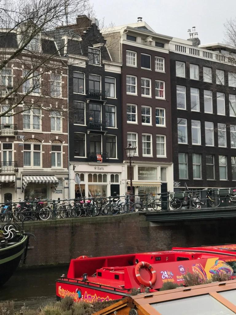 Canali di Amsterdam e barca Rossa