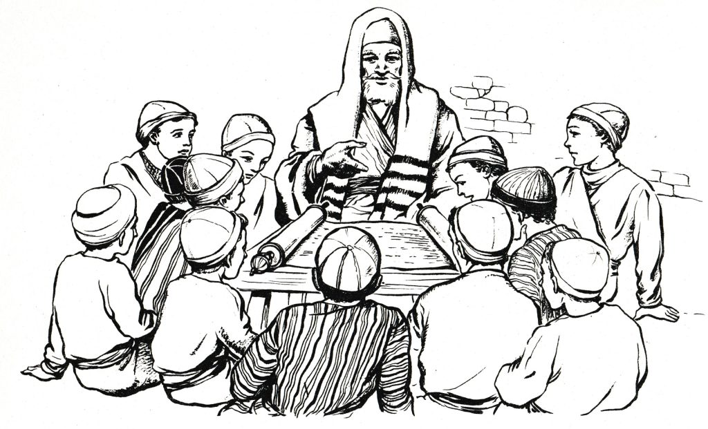 Children learning from a rabbi