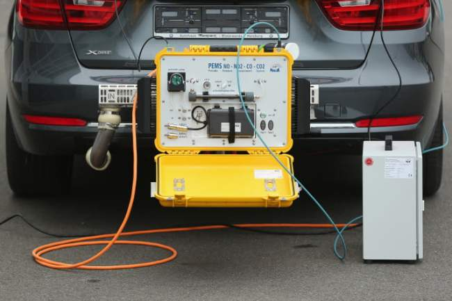 KLETTWITZ, GERMANY - NOVEMBER 25:  A PEMS (Portable Emissions Measurement System) device for testing the emissions of cars in real driving situations is seen attached to the exhaust pipe of a car during a workshop for media on automobile emissions at the DEKRA testing facility on November 25, 2015 in Klettwitz, Germany. European authorities are reconsidering their emissions testing procedures for cars in the wake of the Volkswagen diesel emissions cheating scandal. DEKRA is Germany's biggest independent automotive technical testing agency.  (Photo by Sean Gallup/Getty Images)