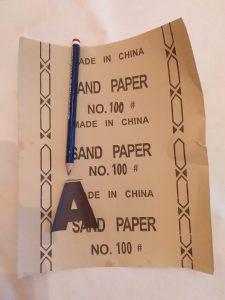 letra A xon un lápiz