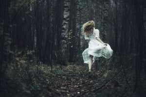 Girl running in the woods