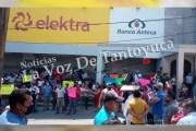 Comerciantes provocan el cierre de Chedraui, Elektra y Coppel