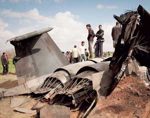 Libyans stand on the wreckage of a US F15 fighter jet.