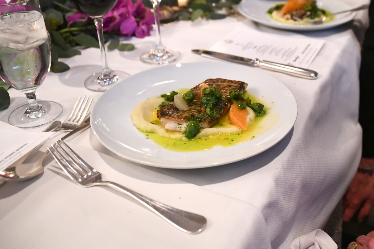 Black bass with fennel puree, winter citrus and green olives in green harissa; Credit: Getty Images