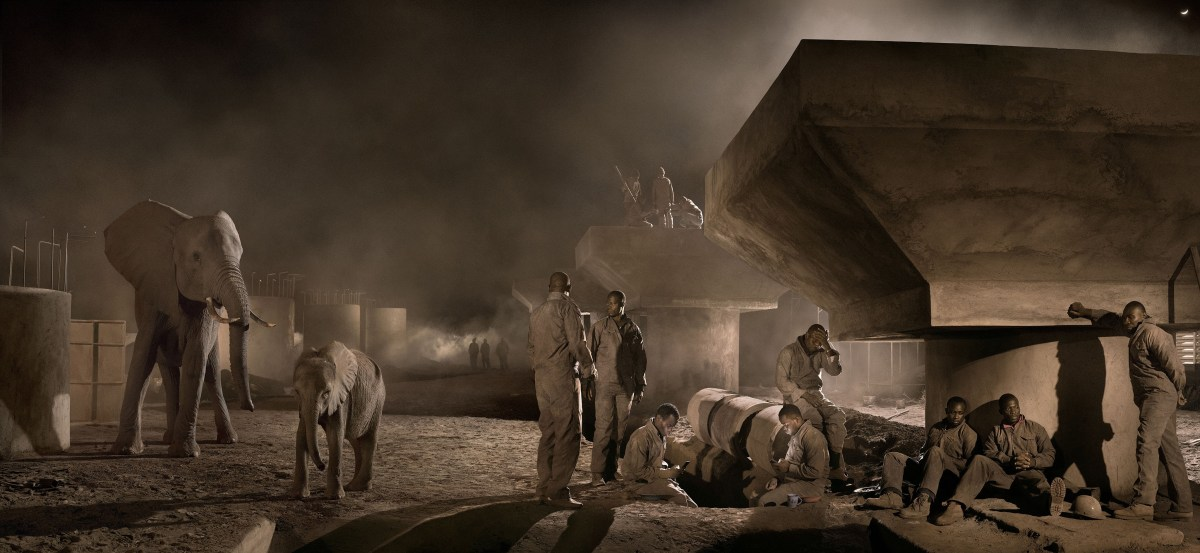 Nick Brandt, Bridge Construction With Elephants & Workers at Night (2018), archival pigment print; Credit: Courtesy of the artist and Fahey/Klein Gallery