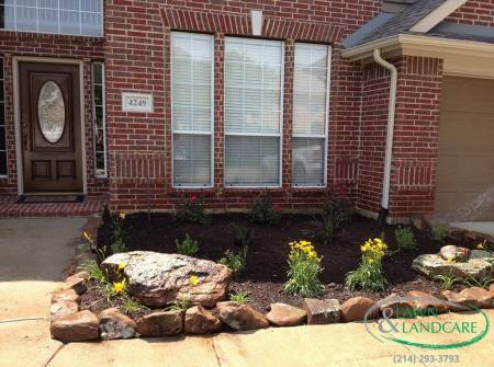 new flowerbed and stone boarder
