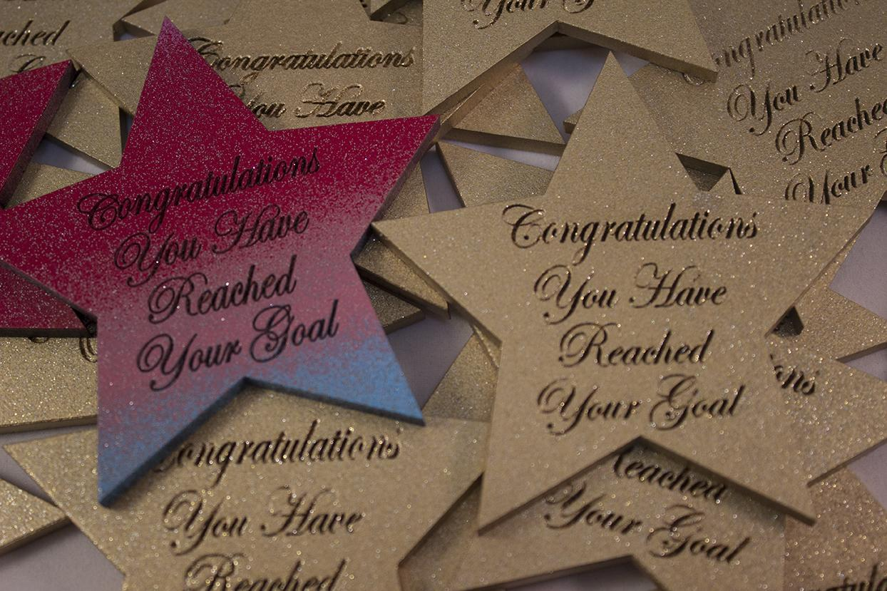 large star shape magnetic congratulations you've reached your goal
