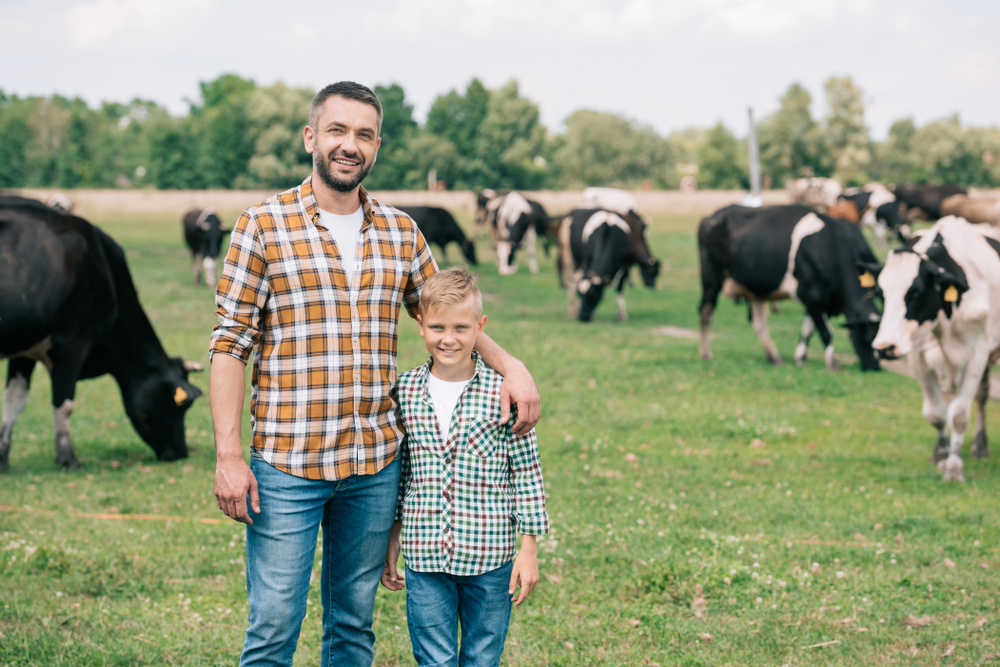 father and son on ranch