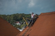 man on a brown roof