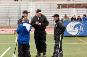 lacrosse officials referees pre game on field