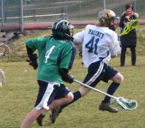 youth lacrosse defender out of position