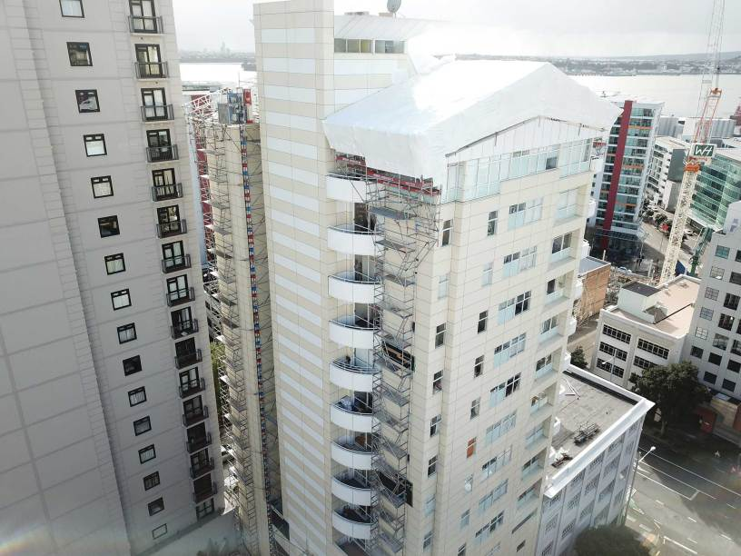 Upright Access Systems provides contractors great access to Cue Vue Apartment rooftop repair project