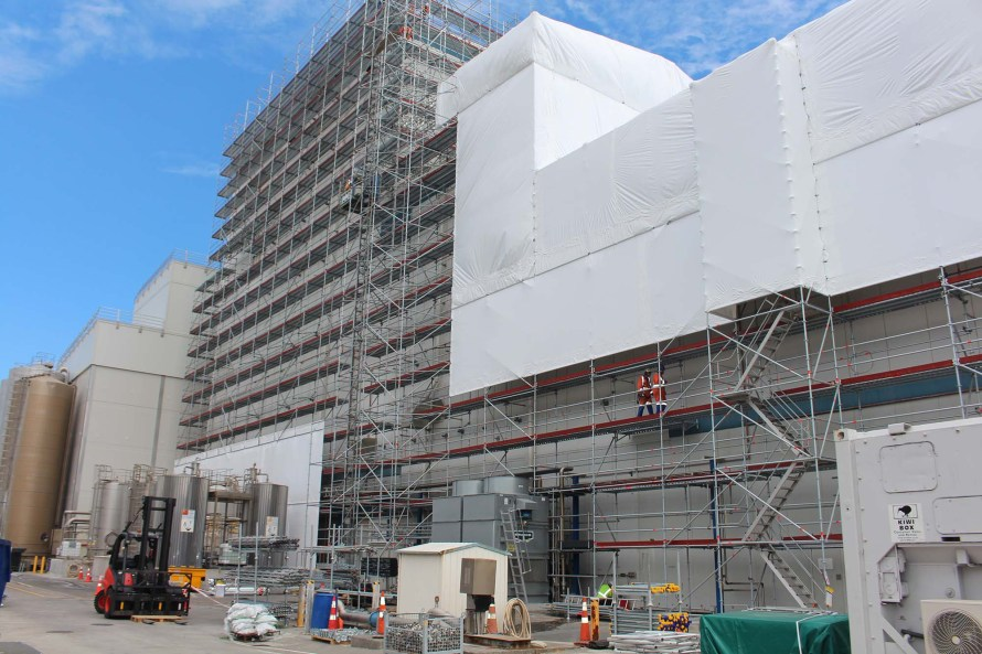 DIALOG Fitzroy use Layher Allround Scaffolding to encapsulate and provide façade access to this massive Fonterra Whey Protein Concentrate (WPC) building Taranaki