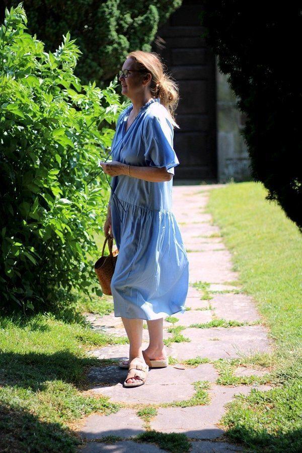 lazy Daisy jones wearing a little blue dress from Arket