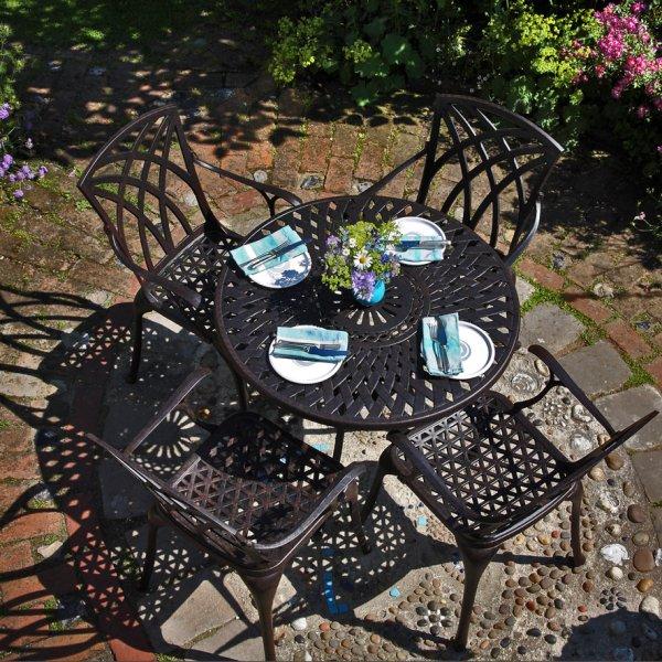 mia antique bronze 90 cm round cast aluminium table table only