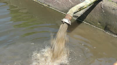 stock-footage-sewage-pipe-polluting-water