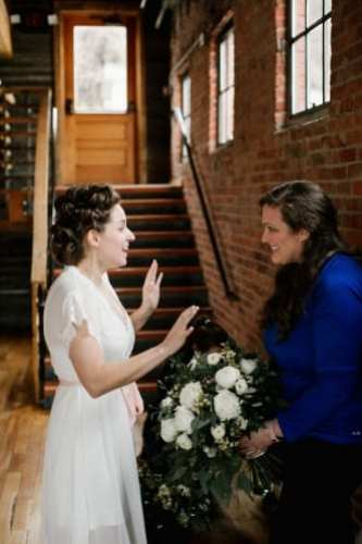 Bride being presented her bridal bouquet by Lesley Britt of LB Floral