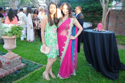 On right, Victoria Bryant wearing a Rammy saree, on left, Jessica Vu wearing Anthropologie Dress with a Chanel bag