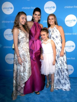HOUSTON, TX - MAY 24: Finley Faith Sehorn, UNICEF Ambassador honoree Angie Harmon, Emery Hope Sehorn and Avery Grace Sehorn at the fourth annual UNICEF Audrey Hepburn® Society Ball on May 24, 2017 in Houston, Texas. (Photo by Bob Levey/Getty Images for UNICEF)