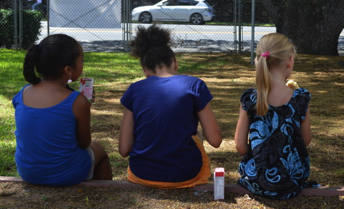 The girls enjoy a quiet snack during Day Camp