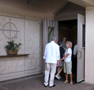 A greeter welcomes members to worship