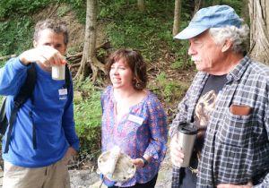 Vergennes teachers examining a water sample
