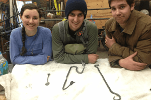 image of student blacksmiths