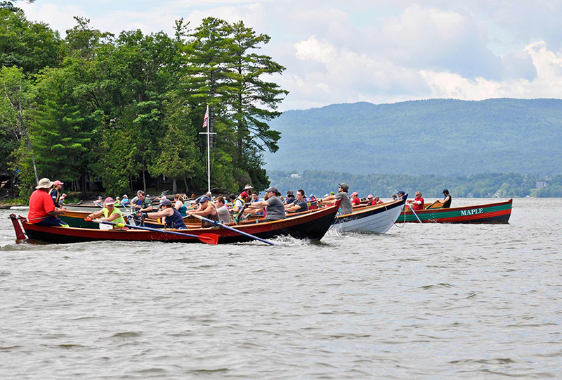 Rowing teams compete in a race